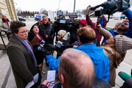 ACLU of Michigan Senior Staff Attorney Mirian Aukerman,  left, and Oliver Law Group Managing Partner Alyson Oliver speak to families outside the U.S. Courthouse Wednesday, Feb. 5, 2020, in Port Huron. The ACLU legal team were in court for a hearing in front of U.S. District Judge Robert Cleland Wednesday egarding the future of Michigan's Sex Offender Registry Act.