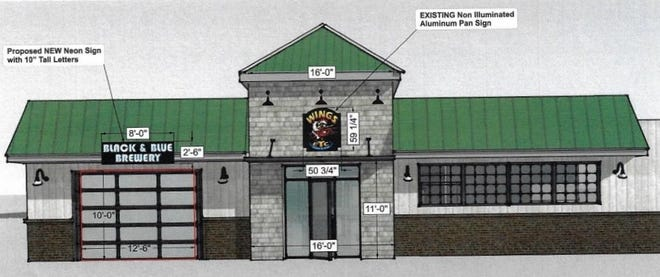 Wings Etc. is proposing new lit signage to its front for both the restaurant and Black and Blue Brewery to help attract customers. Owner Gene Harrison said East Quay Street can be dark at night and that it's difficult for customers to see they're open.