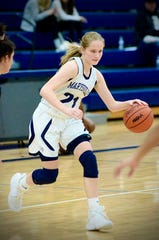 Marysville's Alisyn Hall dribbles against Center Line during a Macomb Area Conference-Gold girls basketball game on Tuesday, Feb. 4, at Marysville.