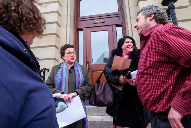 ACLU of Michigan Senior Staff Attorney Miriam Aukerman, left, and Oliver Law Group Managing Partner Alyson Oliver speak to families outside the U.S. Courthouse Wednesday, Feb. 5, 2020, in Port Huron. The ACLU legal team were in court for a hearing in front of U.S. District Judge Robert Cleland Wednesday regarding the future of Michigan's Sex Offender Registry Act.