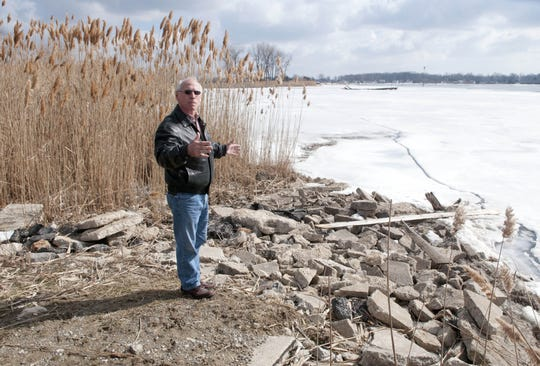 St. Clair County Commissioner Bill Gratopp tours a property with access to the North Channel of the St. Clair River along M-29 in Clay Township in 2013. The county has been trying for several years to identify a property on the southern end to establish as a county park.