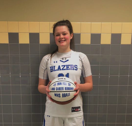 Erin Fox poses with her commemorative 1,000 rebound basketball after the senior reached the milestone in leading Millbrook over Rondout Valley on Feb. 3.