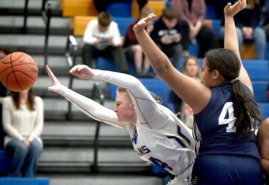 Kennard-Dale's Chandler Swanson loses the ball while driving against West York's Jillian Foster during basketball action at Kennard-Dale Tuesday, Feb. 4, 2020. West York won 26-22. Bill Kalina photo