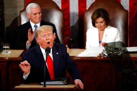 President Donald Trump delivers his State of the Union address to a joint session of Congress on Capitol Hill in Washington, Tuesday, Feb. 4, 2020, as Vice President Mike Pence ad House Speaker Nancy Pelosi of Calif., listen. (AP Photo/Patrick Semansky)