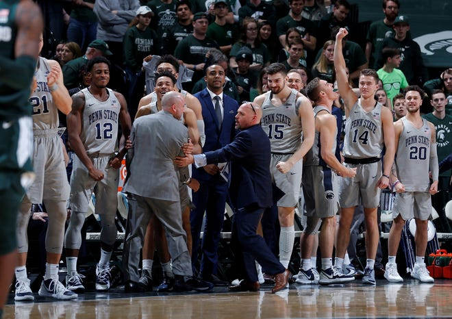 Penn State players and coaches react near the end of the team'sNCAA college basketball game against Michigan State, Tuesday, Feb. 4, 2020, in East Lansing, Mich. Penn State won 75-70. (AP Photo/Al Goldis)