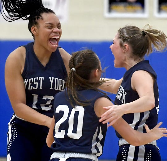 West York's players, from left, Alayna Harris, Makennah Hoffman and Alyssa Zorbaugh celebrate their team's 26-22 win over host Kennard-Dale Tuesday, Feb. 4, 2020. Bill Kalina photo
