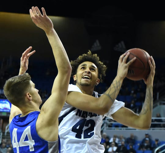 Nevada's K.J. Hymes looks to shoot over Air Force's Keaton Van Soelen during Tuesday's game at Lawlor Events Center.
