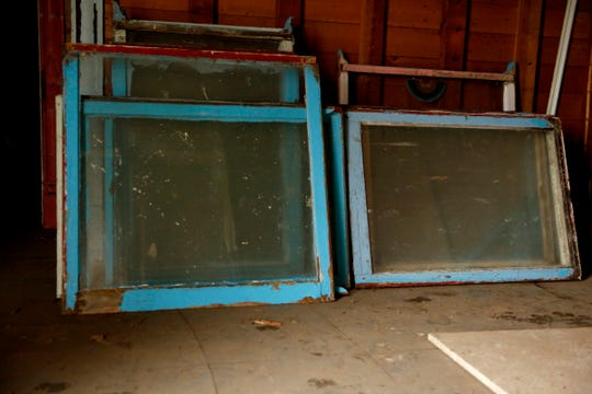 Original windows that have been salvaged from the home.