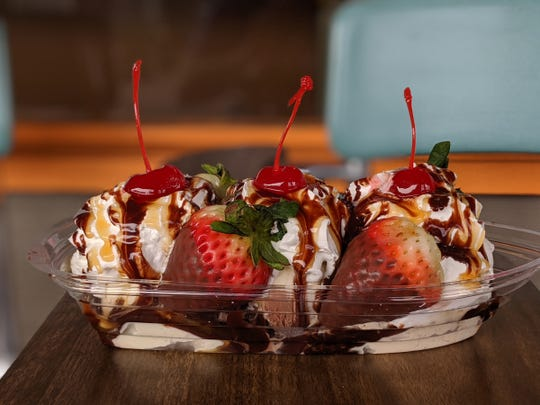 The Love Boat ($7)is three scoops of ice cream with hot fudge, whipped cream, chocolate and caramel syrups, two chocolate-covered strawberries and three maraschino cherries.