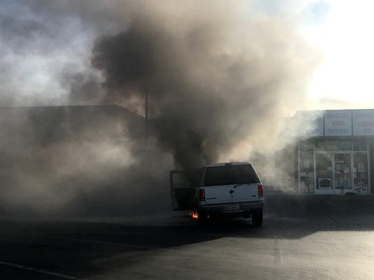Smoke billowed across a South Salinas parking lot from a car that caught fire Feb. 5, 2020.