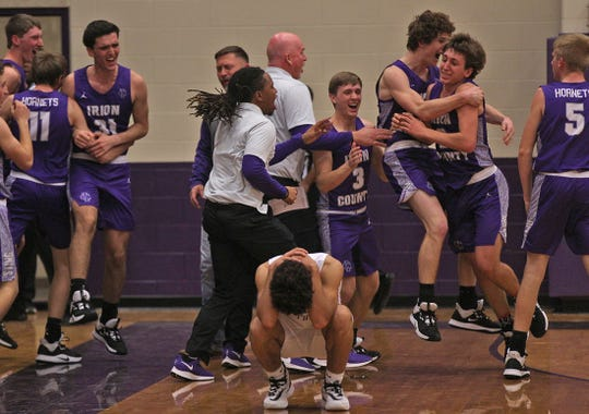 The Irion County team celebrates a win on a buzzer beater shot against Sterling City on Tuesday, Feb. 4, 2020.