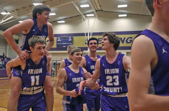 Members of the Irion County basketball team celebrate a win against Sterling City on Tuesday, Feb. 4, 2020.