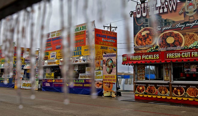 Icicles form on a food vendor's exterior at the San Angelo Stock Show and Rodeo carnival after winter weather struck San Angelo early Wednesday, Feb. 5, 2020.