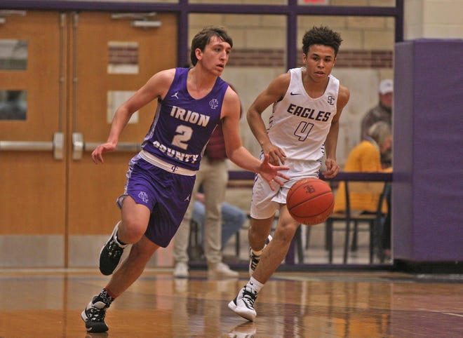 Kaden Councilman (2) dribbles the ball up the court for Irion County ahead of Sterling City's Isaiah Arellano (4) during a game in Sterling City Tuesday, Feb. 4, 2020.