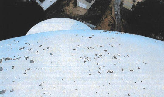 The roof of the water tank has fungus growth and heavy chalking, according to Chincoteague.