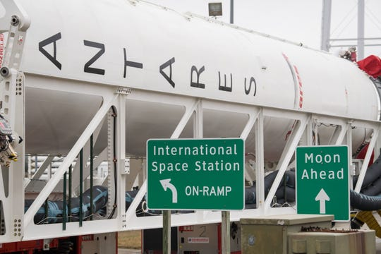 Signs are seen along the road as the Northrop Grumman Antares rocket is rolled out to Pad-0A, Wednesday, Feb. 5, 2020, at NASA's Wallops Flight Facility in Virginia.