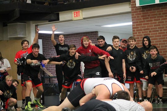 Brandon Valley teammates cheer on Sam Lembcke as he wrestles against Rapid City Stevens. The Lynx defeated the top-ranked Raiders 39-33 on Jan. 25.