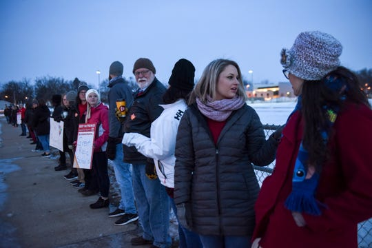 Teachers stand together to protest a lack of funding for education by the state during a walk-in on Wednesday, Feb. 5, 2020 at Robert Frost Elementary School. Similar protests were held around the district.
