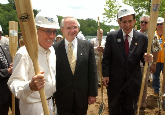 In a file photo, Branson entertainer Andy Williams, left, and Governor Bob Holden, center, pause for pictures after the groundbreaking for Branson Landing,