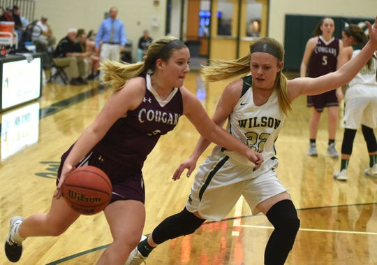 Stuarts Draft's McKinley Fitzgerald tries to get around Wilson Memorial's Ashley Morani in a Shenandoah District girls basketball game in Fishersville Tuesday, Feb. 4.