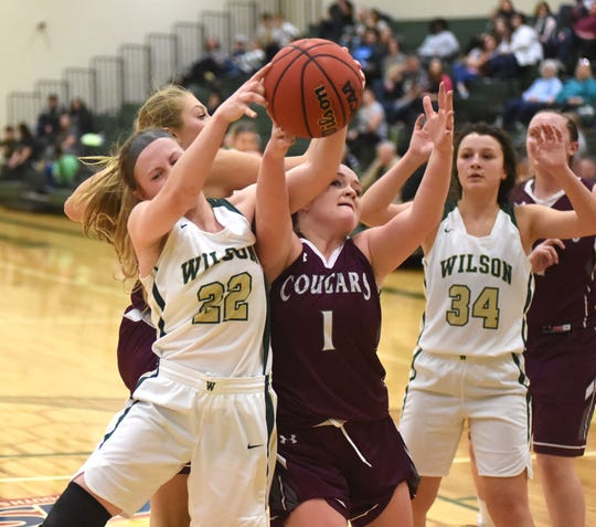 Wilson Memorial's Ashley Morani and Stuarts Draft's Madi Armentrout battle for a rebound in a Shenandoah District girls basketball game in Fishersville Tuesday, Feb. 4.