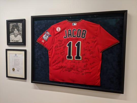 A picture of Jacob Wetterling and a Twins jersey with his name, signed by the members of the 2016 team, adorn the walls of the Jacob Wetterling Resource Center in St. Paul.