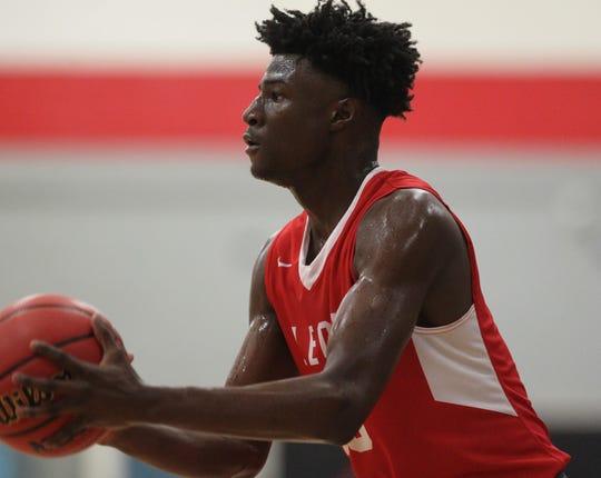 Leon senior Carter Mason shoots a 3-pointer as Leon's boys basketball team beat NFC 68-44 on Feb. 4, 2020.