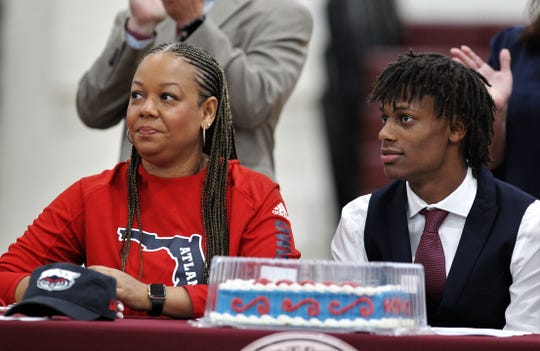 Florida High quarterback Willie Taggart Jr. and mother Taneshia listen during national signing day, Wednesday, Feb. 5, 2020. Taggart Jr. signed with Florida Atlantic.