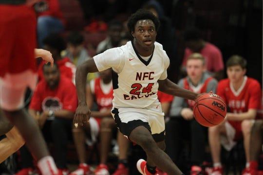 NFC junior Deandrae McCray drives baseline as Leon's boys basketball team beat NFC 68-44 on Feb. 4, 2020.