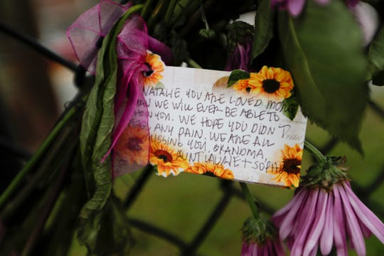 Flowers and a wreath memorializing Natalie Nickchen, who died after being hit by a car on East Tennessee Street last week, hang on the fence at the end of the crosswalk she was killed in Wednesday, Feb. 5, 2020.