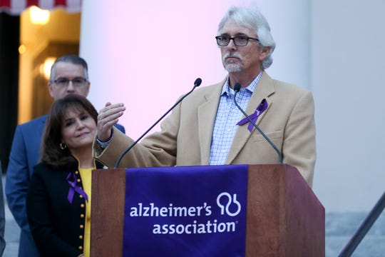 Bobby Marshall, a Tampa-area teacher who was diagnosed with Alzheimer's at the young age of 55, speaks at the Alzheimer's Association Rally in Tally purple lighting ceremony Tuesday, Feb. 4, 2020.