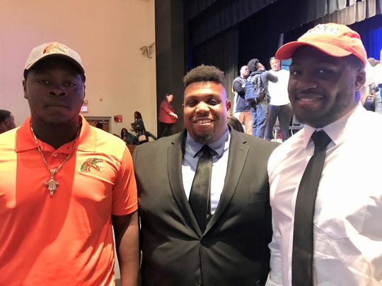 Michael Brown (left) and Christof Troupe of Godby High School celebrated National Signing Day with Cougars head coach Brandon McCray. Brown and Troupe signed with FAMU on Wednesday, Feb. 5, 2020.
