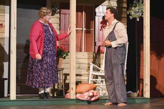"""Alice Clark (Renee Valentine) talks with William Hughes (Eric Olson) on her front porch in """"Sweet Tea .and the Front Porch,"""" presented by the Panhandle Players in Apalachicola."""