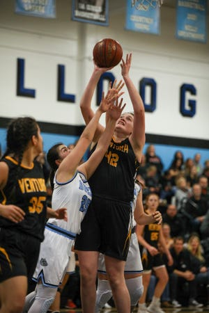 Ventura center Amaya Fuentes shoots over Buena guard Sofia Decierdo during a Pacific View League girls basketball game on Tuesday night at Buena High.