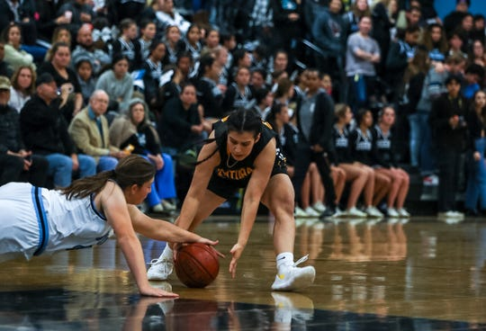 Buena's Savannah Cervantes and Ventura's Alexis Howery reach for a loose ball during a Pacific View League girls basketball game on Tuesday night at Buena High.