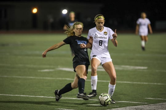 Ventura's Mady Dannenberg tries to hold off Buena midfielder Taylin Butterbaugh in a Pacific View League girls soccer match on Tuesday night at Buena High.