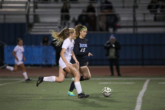 Buena striker Abigail Wood is chased by Ventura midfielder Allie Nichols in a Pacific View League girls soccer match on Tuesday night at Buena High.