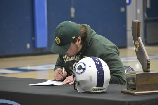 Central Valley Christian High School senior Dirk Nelson signs his letter of intent on Feb. 5, 2020 to play college football at Colorado State.