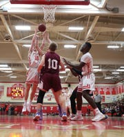Tappan Zee's Connor Maloney (10) reaches for a rebound during their 54-41 win over Albertus in boys varsity basketball action at Tappan Zee High School in Orangeburg on Tuesday, February 4, 2020.