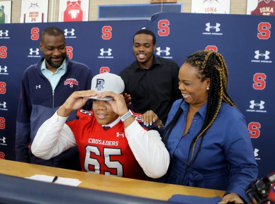 Archbishop Stepinac H.S. football player Ajani Cornelius announced he would be attending the University of Rhode Island during a signing ceremony at the high school Feb. 5, 2020. With Ajani was his mother Yasmin, father Tchiyuka, and brother Tchiyuka, Jr.