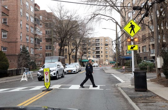 Sergeant Nick Reckson, commanding officer of the Traffic and Safety Unit of the Greenburgh Police Department demonstrates how they enhanced the crosswalk with rectangular rapid-flashing beacons during a ride along Feb. 5, 2020 in Hartsdale.