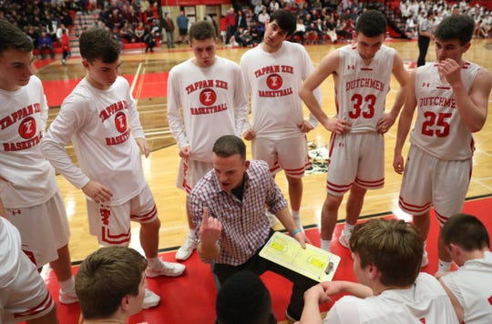 Tappan Zee head coach George Gaine talks to his players after the first quarter during their 54-41 win over Albertus in boys varsity basketball action at Tappan Zee High School in Orangeburg on Tuesday, February 4, 2020.