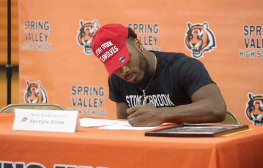 Jayden Cook, a 2019 graduate of Spring Valley High School, signing a National Letter of Intent to play football for Stony Brook University at Spring Valley High School on Wednesday, February 5, 2020.