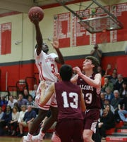 Tappan Zee's David Alexandre (3) goes over Albertus' Connor Johnson (33) and  Nevin Noor (13) during their 54-41 win over Albertus in boys varsity basketball action at Tappan Zee High School in Orangeburg on Tuesday, February 4, 2020.