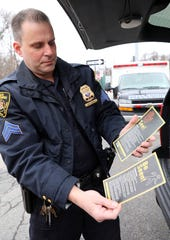 Sergeant Nick Reckson, commanding officer of the Traffic and Safety Unit of the Greenburgh Police Department shows the safety tips they hand out to the community Feb. 5, 2020.