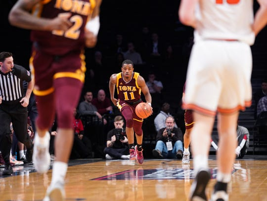 Iona point guard Isaiah Washington takes the ball upcourt during the Gaels' Dec. 17 game against Princeton at the Barclays Center in Brooklyn, N.Y.