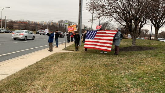 Concord Pike commuters greetedsome 60 people in Talleyville as theyprotestedSenate acquittingPresident Donald Trump impeachment charges Wednesday afternoon.