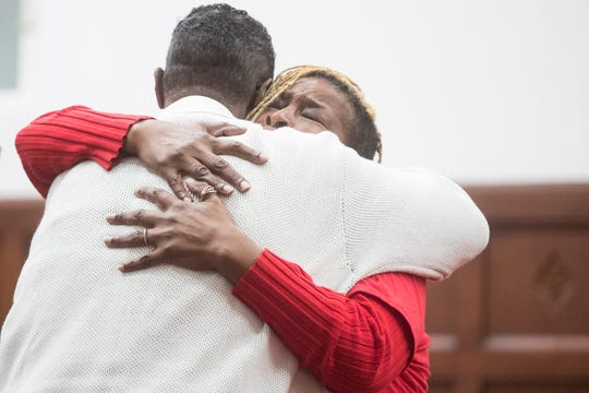 Wilmington mother Tondra Mangrum, who has lost multiple family members to gun violence in Wilmington, hugs Bethel AME Pastor Silvester Beaman during an 'Hour of Power' event for National Gun Violence Survivors Week on Wednesday at Bethel AME Church in downtown Wilmington.