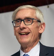 Governor Tony Evers laughs about his experience of watching the taxidermy of a squirrel at the Wisconsin Farm Bureau Ag Day at the Capitol at Monona Terrace in Madison on Feb. 4, 2020. Evers applauded the support agriculture groups have given to support agriculture education.