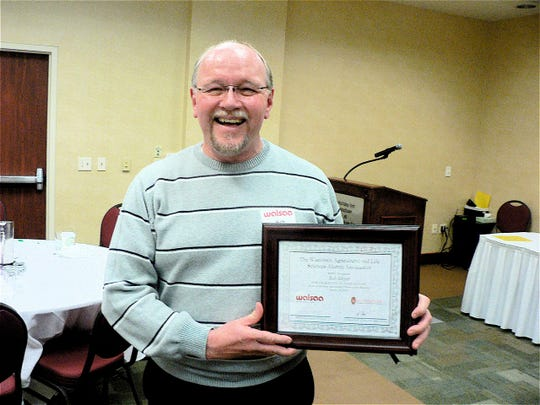 Bob Meyer of Marshfield, longtime radio farm director, now an ag banker was honored as Friend of Farm Short Course.